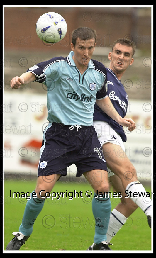 28/9/02       Copyright Pic : James Stewart                     .File Name : stewart-falkirk v st j'stone 15.STEVEN RENNIE GOES IN FROM BIHIND ON CHRIS HAY....James Stewart Photo Agency, 19 Carronlea Drive, Falkirk. FK2 8DN      Vat Reg No. 607 6932 25.Office : +44 (0)1324 570906     .Mobile : + 44 (0)7721 416997.Fax     :  +44 (0)1324 570906.E-mail : jim@jspa.co.uk.If you require further information then contact Jim Stewart on any of the numbers above.........
