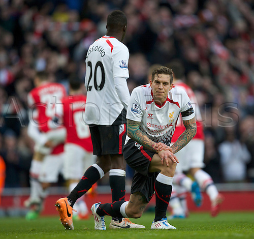 16.02.2014 London, England. Daniel Agger of Liverpool is annoyed as Arsenal take the lead during the FA Cup 5th Round game between Arsenal and Liverpool from the Emirates Stadium.