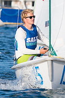 Skipper Sean Beaulieu,'18, heads to a marker as the Salve Regina Sailing Team practices in the Newport Harbor.