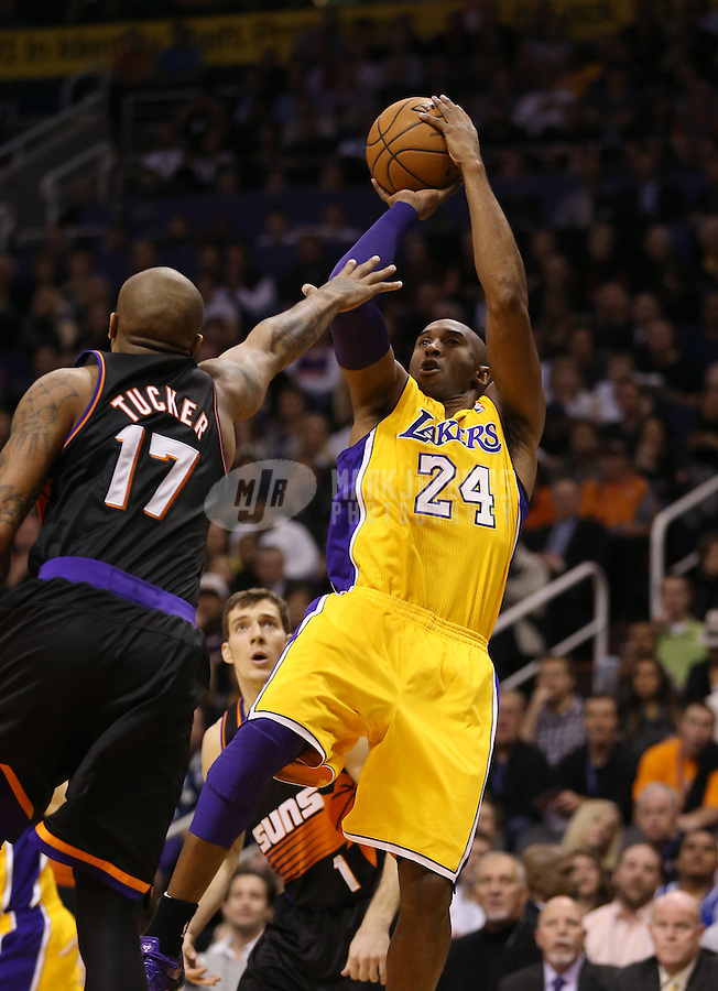 Jan. 30, 2013; Phoenix, AZ, USA: Los Angeles Lakers guard Kobe Bryant takes a shot against the Phoenix Suns in the first quarter at the US Airways Center. Mandatory Credit: Mark J. Rebilas-