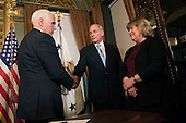 Retired United States Marine Corps General John Kelly shakes hands with Vice President Mike Pence after being sworn-in as Secretary of Homeland Security, in the Vice Presidential ceremonial office in the Executive Office Building in Washington, D.C. on January 20, 2017.     <br /> Credit: Kevin Dietsch / Pool via CNP