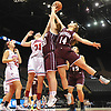 Julia Rawlinson #14 of Mepham, right, and sister Meghan Rawlinson #30, center, go up for a rebound alongside Dorianna Cardon #31 of MacArthur during a Nassau varsity girls basketball game played at NYCB Live's Nassau Coliseum in Uniondale on Saturday, Dec. 23, 2017. Julia Rawlinson recorded 18 points and 12 rebounds in Mepham's 45-40 win.