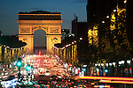 The night view of Avenue des Champs-Élysées with Arc de Triomphe in the background. Paris. France