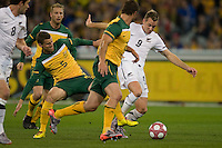 MELBOURNE, AUSTRALIA - MAY 24, 2010: Jason Culina of the Qantas Socceroos fights with Shane Smeltz of New Zealand for the ball at the FIFA World Cup farewell match between Australia and New Zealand at the Melbourne Cricket Ground, 24 May, 2010 in Melbourne, Australia. Photo by Sydney Low / www.syd-low.com
