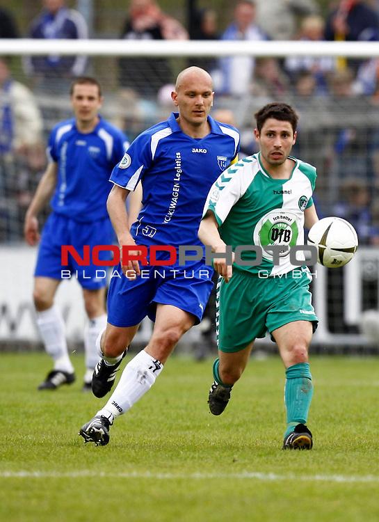 RLN 2007/2008 32. Spieltag  R&uuml;ckrunde<br /> BSV Kickers Emden -  VfB L&uuml;beck<br /> Giuseppe Canale (VfB L&uuml;beck / Luebeck # 16) - Rudolf Zedi (Kickers Emden # 25)<br /> Foto &copy; nph (  nordphoto  )<br /> <br /> <br /> <br />  *** Local Caption ***