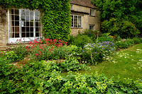 House front with garden. The Cotswolds, England