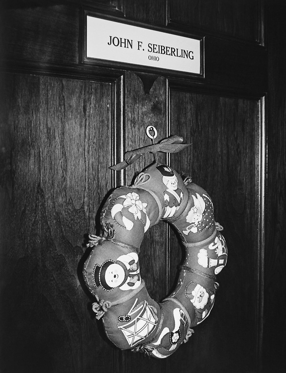 Decorated office door of Rep. John F. Seiberling, D-Ohio, with wreath during Christmas contest in 1983. (Photo by CQ Roll Call via Getty Images)