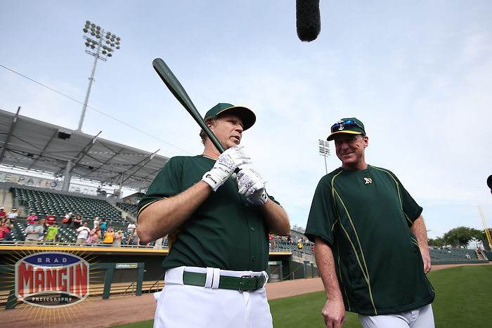 MESA, AZ - MARCH 12:  Actor Will Ferrell of the Oakland Athletics talks with manager Bob Melvin before a spring training game against the Seattle Mariners at HoHoKam Stadium on March 12, 2015 in Mesa, Arizona. (Photo by Brad Mangin)