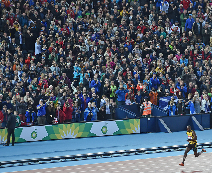 Jamaica's Usain Bolt completes the win for his nation in the 4x100m final<br /> <br /> Photographer Chris Vaughan/CameraSport<br /> <br /> 20th Commonwealth Games - Day 10 - Saturday 2nd August 2014 - Athletics - Hampden Park - Glasgow - UK<br /> <br /> © CameraSport - 43 Linden Ave. Countesthorpe. Leicester. England. LE8 5PG - Tel: +44 (0) 116 277 4147 - admin@CameraSport.com - www.CameraSport.com