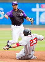 Winston-Salem Dash shortstop Marcus Semien #2 turns a double play as Justin Bloxom #23 of the Potomac Nationals slides into second base at BB&T Ballpark on April 25, 2012 in Winston-Salem, North Carolina.  The Dash defeated the Nationals 14-0.  (Brian Westerholt/Four Seam Images)