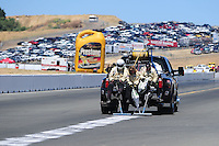 Jul. 18, 2010; Sonoma, CA, USA; NHRA safety safari personnel clean up an oil spill during the Fram Autolite Nationals at Infineon Raceway. Mandatory Credit: Mark J. Rebilas-