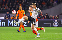 Toni Kroos (Deutschland Germany) gegen Marten de Roon (Niederlande) - 24.03.2019: Niederlande vs. Deutschland, EM-Qualifikation, Amsterdam Arena, DISCLAIMER: DFB regulations prohibit any use of photographs as image sequences and/or quasi-video.