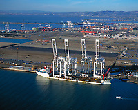 aerial photograph ZPMC vessel unloading cranes from Shanghai China at the Port of Oakland, California