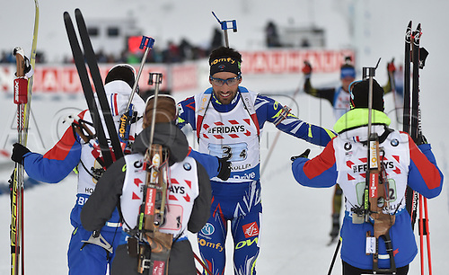 03.03.2016. Holmenkollen, Oslo, Norway.  The relay team of France with (L-R) Quentin Fillon Maillet, Marie Dorin Habert, Martin Fourcade and Anais Bescond celebrate winning the gold medal during the Mixed Relay competition at the Biathlon World Championships, in the Holmenkollen Ski Arena, Oslo, Norway, 03 March 2016.