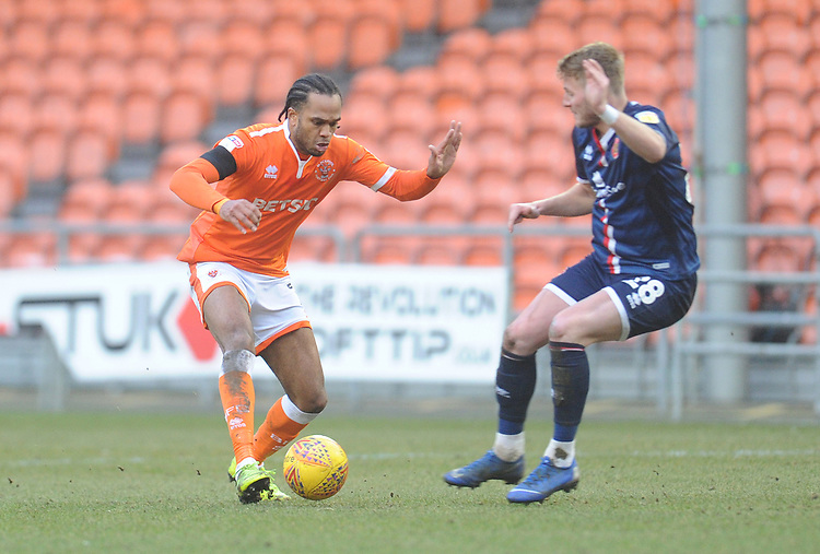 Blackpool's Nathan Delfouneso under pressure from Walsall's Kane Wilson<br /> <br /> Photographer Kevin Barnes/CameraSport<br /> <br /> The EFL Sky Bet League One - Blackpool v Walsall - Saturday 9th February 2019 - Bloomfield Road - Blackpool<br /> <br /> World Copyright © 2019 CameraSport. All rights reserved. 43 Linden Ave. Countesthorpe. Leicester. England. LE8 5PG - Tel: +44 (0) 116 277 4147 - admin@camerasport.com - www.camerasport.com