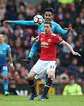 Nemanja Matic of Manchester United tackled by Pierre-Emerick Aubameyang of Arsenal during the premier league match at the Old Trafford Stadium, Manchester. Picture date 29th April 2018. Picture credit should read: Simon Bellis/Sportimage