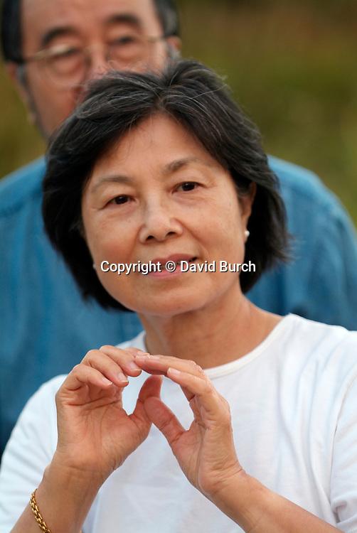 Asian woman doing Tai Chi, hands