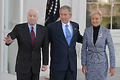 Washington, DC - March 5, 2008 -- United States Senator John McCain (Republican of Arizona), left, the presumptive 2008 Republican nominee for President of the United States waves to the cameras as United States President George W. Bush, and  Cindy McCain, right, looks on on the North Portico of the White House on Wednesday, March 5, 2008..Credit: Ron Sachs / CNP