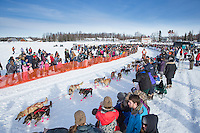 Jake Berkowitz runs down the chute leaving the restart of the Iditarod sled dog race at Willow, Alaska Sunday, March 3, 2013.