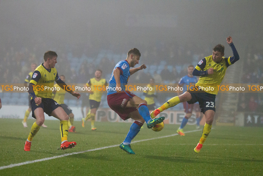 Ryan Ledson of Oxford tackles Jamie Ness of Scunthorpe during Scunthorpe United vs Oxford United, Sky Bet EFL League 1 Football at Glanford Park on 26th November 2016