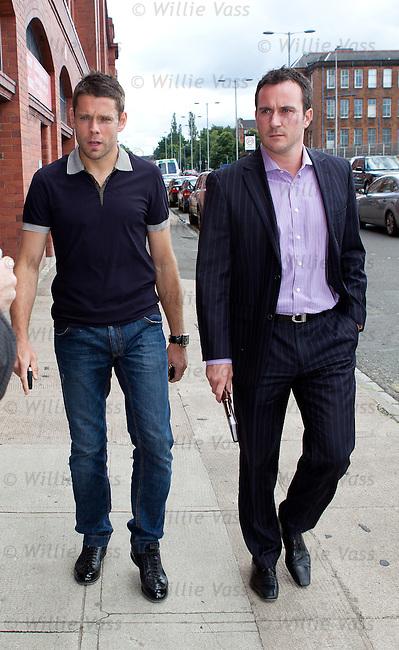 Striker James Beattie leaving Ibrox Stadium with his agent