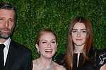 (L-R) Bart Freundlich, Julianne Moore and Liv Freundlich arrive at the MoMa Film Benefit Tribute to Julianna Moore presented by Chanel, at the Musuem of Modern Art in New York City, on November 13, 2017.