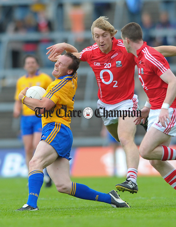 John Hayes of Clare in action against Denis O Sullivan of Cork during the Munster senior football final at The Gaelic Grounds, Limerick. Photograph by John Kelly.