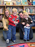 From left, Michelle Pedersen, her son Jack, 3, Sara Ross and her daughter Sawyer, 2-1/2, dance during Storytime at the Carson City Library, in Carson City, Nev. on Thursday, Nov. 29, 2012..Photo by Cathleen Allison