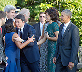Prime Minister Matteo Renzi of Italy hugs United States National Security Advisor Susan Rice as US Vice President Joe Biden greets Mrs. Agnese Landini prior to the arrival ceremony at the start of an Official Arrival Ceremony on the South Lawn of the the White House in Washington, DC on Tuesday, October 18, 2016. US President Barack Obama looks on from right. <br /> Credit: Ron Sachs / CNP