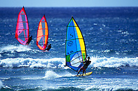 Three windsurfers at Backyards Sunset Beach, Oahu