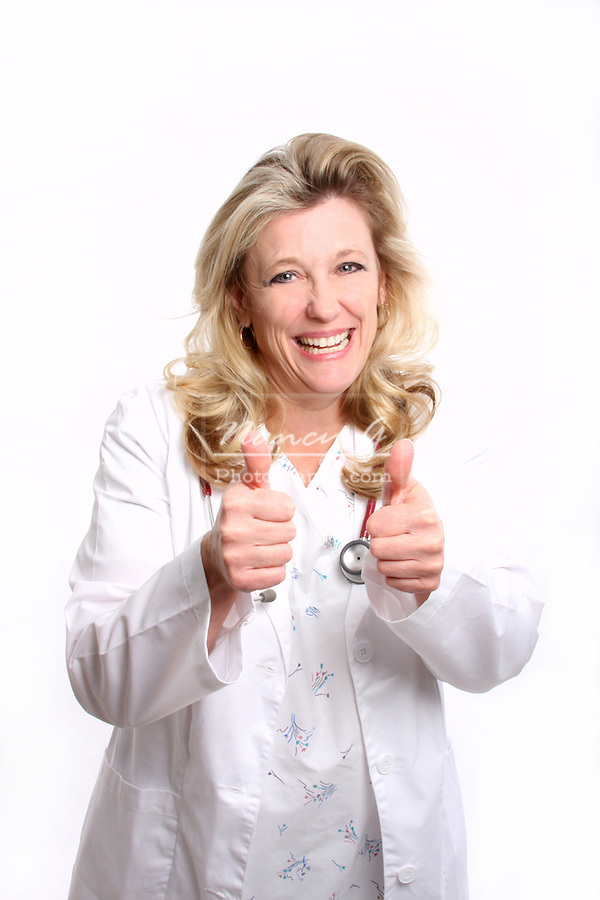 A woman doctor with two thumbs up in approval