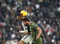 Calcio, Serie A: Juventus - Cagliari, Turin, Allianz Stadium, January 6, 2020.<br /> Juventus' Cristiano Ronaldo (l) in action with Cagliari's Paolo Farago (r) during the Italian Serie A football match between Juventus and Cagliari at Torino's Allianz stadium, on January 6, 2020.<br /> UPDATE IMAGES PRESS/Isabella Bonotto