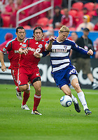 24 July 2010: FC Dallas defender/midfielder Brek Shea #20 and Toronto FC defender Nick Garcia #4 in action during a game between FC Dallas and Toronto FC at BMO Field in Toronto..The final score was a 1-1 draw...