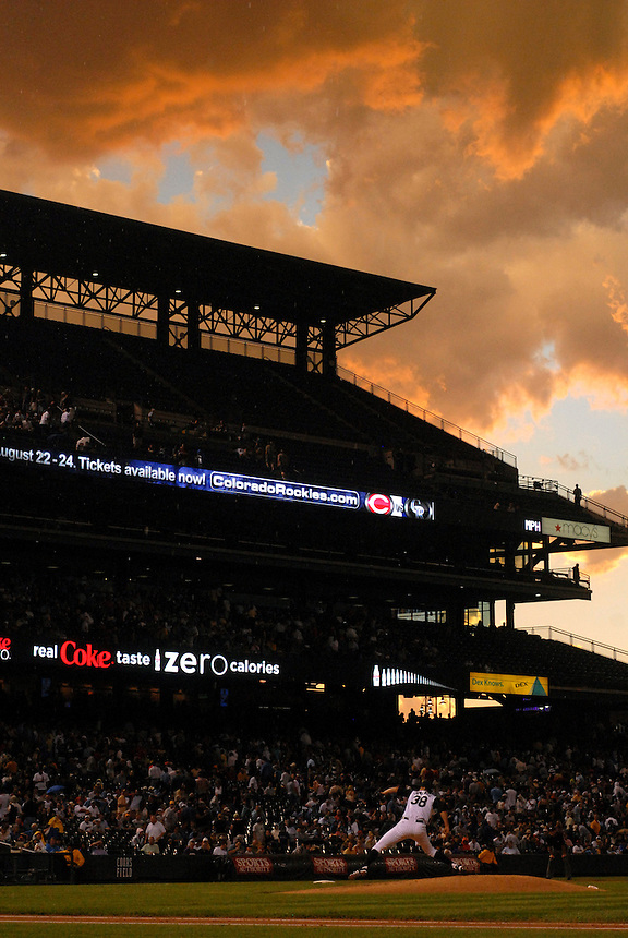 12 August 08: Rockies pitcher Ubaldo Jimenez delivers a pitch as the sun sets during a game between the Arizona Diamondbacks and the Colorado Rockies at Coors Field in Denver, Colorado.