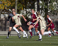 Florida State midfielder Amanda DaCosta (13) brings ball out as Boston College defenders close. Florida State University defeated Boston College, 1-0, at Newton Soccer Field, Newton, MA on October 31, 2010.