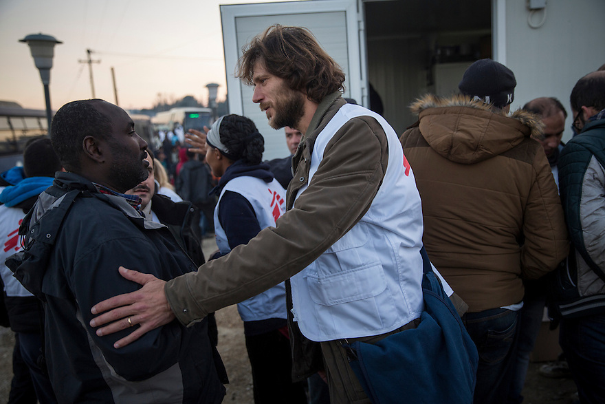 Pierluigi Taffon, Health Promoter with MSF talks to Somali refugee outside the MSF container clinic in Idomeni, Greece, where several thousand people were stranded in December, unable to cross into Macedonia due to nationality restrictions put in place by several Balkan nations. Meanwhile many thousands of Syrians, Afghans and Iraqis passed through the border each day after having their documents checked by Macedonian border police.