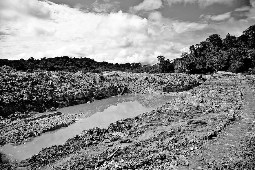 Amazon rain forest deforestation at Agua Branca gold mining village, , Para State, Brazil. Ponds of dirt water left behind after hydraulic mining was performed, a form of mining that uses high-pressure jets of water to dislodge rock material or move sediment. The discarded material is piped away forming lakes of discarded mud.