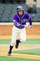 Cody Jones (12) of the Western Carolina Catamounts hustles down the first base line against the Wake Forest Demon Deacons at Wake Forest Baseball Park on March 26, 2013 in Winston-Salem, North Carolina.  The Demon Deacons defeated the Catamounts 3-1.  (Brian Westerholt/Four Seam Images)