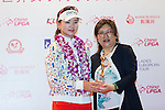 Shi Yuting of China (left) receives the best dress Trophy from the hands of Jennifer Lee, CLPGT, during the Prize giving ceremony of the World Ladies Championship 2016 on 13 March 2016 at Mission Hills Olazabal Golf Course in Dongguan, China. Photo by Victor Fraile / Power Sport Images
