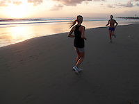 Evening exercise on the Kuta beach. Bali, Indonesia.<br /> July 2009.<br /> Only for editorial use.