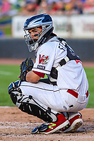 Wisconsin Timber Rattlers catcher Mario Feliciano (4) looks in to the dugout during game one of a Midwest League doubleheader against the Kane County Cougars on June 23, 2017 at Fox Cities Stadium in Appleton, Wisconsin.  Kane County defeated Wisconsin 4-3. (Brad Krause/Four Seam Images)