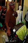 October 1, 2009:  Bobby Brown and baby Cassius at the Anat B store opening party at  the Westfield Century City Mall in Los Angeles, California..Photo by Nina Prommer/Milestone Photo