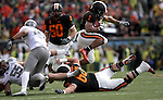 12/04/10-- Oregon State running back Jacquizz  Rodgers leaps over his own player in the first half of the Civil War game at Reser Stadium in Corvallis, Or..Photo by Jaime Valdez......