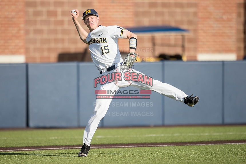 Michigan Wolverines third baseman Jimmy Kerr (15) prepares to make a throw to first base against the Central Michigan Chippewas on May 9, 2017 at Ray Fisher Stadium in Ann Arbor, Michigan. Michigan defeated Central Michigan 4-2. (Andrew Woolley/Four Seam Images)