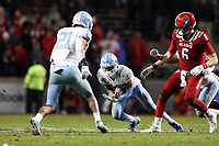 RALEIGH, NC - NOVEMBER 30: Don Chapman #13 of the University of North Carolina intercepts the ball during a game between North Carolina and North Carolina State at Carter-Finley Stadium on November 30, 2019 in Raleigh, North Carolina.
