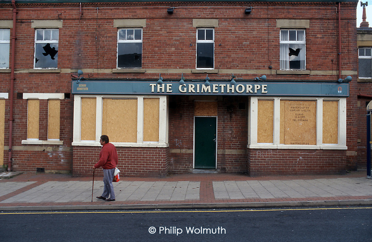 Empty and vandalised pub in the ex-mining village of Grimethorpe, South Yorkshire, where the colliery closed in 1992.