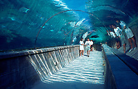 People walking through Atlantis resort underwater walkway. Paradise Island, Bahamas.