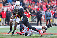 College Park, MD - November 26, 2016: Maryland Terrapins running back Ty Johnson (6) gets tackled by Rutgers Scarlet Knights defensive back Saquan Hampton (9) during game between Rutgers and Maryland at  Capital One Field at Maryland Stadium in College Park, MD.  (Photo by Elliott Brown/Media Images International)
