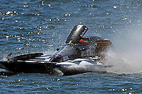 "Frame 2: Jay Gignac, GNH-55 ""Gi Wizz"" returns to the pits with the left sponson blown out and damage to the right.  (Grand National Hydroplane(s)"