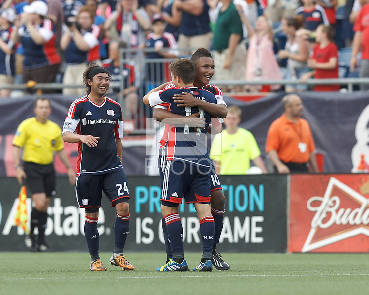 New England Revolution substitute midfielder Kelyn Rowe (11) celebrates his goal with teammates.  In a Major League Soccer (MLS) match, the New England Revolution (blue) defeated LA Galaxy (white), 5-0, at Gillette Stadium on June 2, 2013.